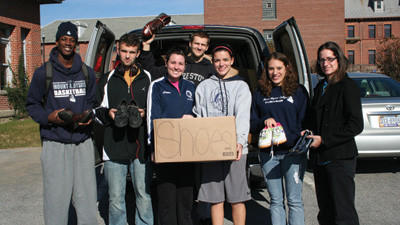 Members of the Mount Aloysius College Mens Basketball and Ladies Volleyball teams gather to help Head Volleyball Coach Brianna Baker, at far right, make yet another delivery of donated shoes for Soles4Souls. From left are: Dameon Turner, Stafford, VA; Jeff Stem, Oakland, MD; Chelsea Perehinec, Altoona, Pa.; Clint Wagner, Reedsville, WV; Lauren Oldham, Nanty Glo, Pa.; Ashley Manges, of Central City, Pa. and Coach Briana Baker.