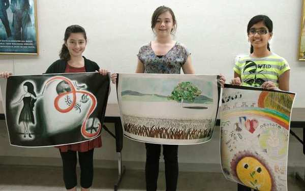 Burbank Noon Lions Club International Peace Poster Contest winners are, from left, Margo Akopov, 13, who attends John Muir Middle School and was representing the Boys and Girls Club; Micayla Siemon, 13, representing Luther Burbank Middle School; and Tanishka Nair, 11, representing Jordan Middle School.