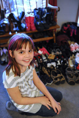Lauryn Cottrell, 10, of Northampton, collected 91 pairs of shoes in 5 weeks to donate to the poor.
