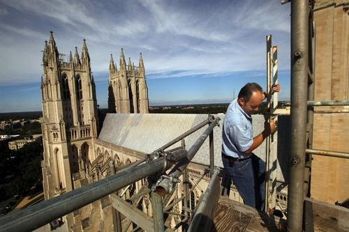 Joe Alonso, the Episcopal cathedral's master stonemason, climbs to a pinnacle on the south transept. The pinnacle rotated several inches in the quake.