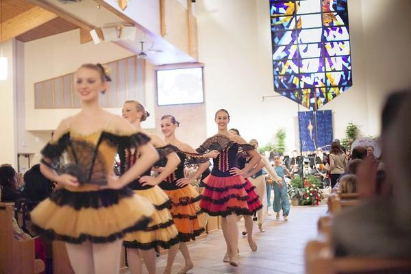 "Mount Dora School of Ballet students performing in 'The Nutcracker Suite."" These dancers are in the Spanish Chocolate segment of the ballet."