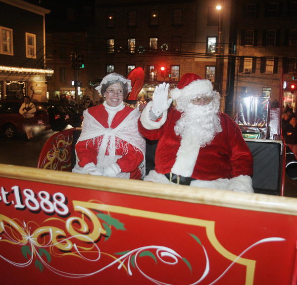 Mr. and Mrs. Santa Claus ride in a sleigh through the annual Midnight Madness celebration in downtown Ellicott City. The annual event, usually held in early December, finds several Main Street shops and restaurants staying open later and offering several deals for shoppers.