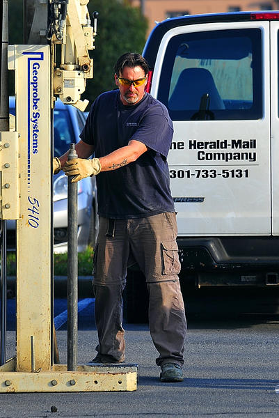 Don Marchese, of Green Services Inc. of Baltimore, bores into The Herald-Mail Co. parking lot in Hagerstown Tuesday to gather soil samples at the proposed site of a new stadium. The samples are to be tested to determine if the ground is safe for construction and to check for any underlying hazards.