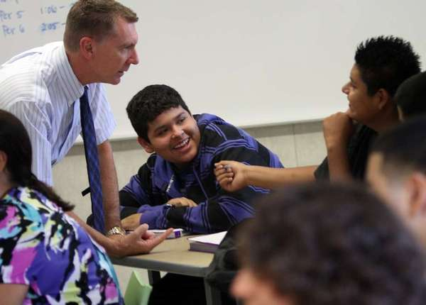 Los Angeles Unified School District Supt. John Deasy chats with students on the first day of classes at the Hilda L. Solis Learning Academy in East Los Angeles on Aug. 14.