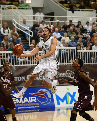 Lehigh's Anthony D'Orazio (center) moves in for a basket as he is guarded by Fordham's Bryan Smith (left) and Ryan Rhoomes (right) during basketball game at Stabler Arena on Tuesday, December 4, 2012. /