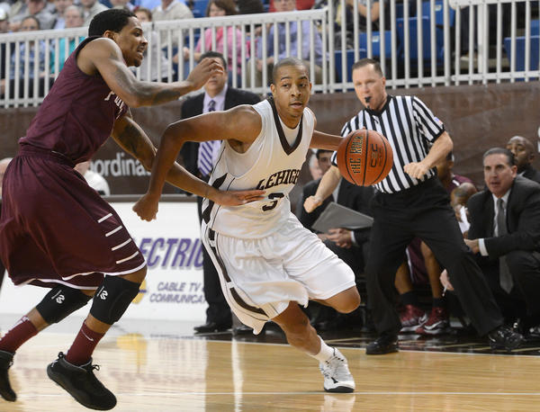 Lehigh's C.J. McCollum moves the ball while being guarded by Fordham's Branden Frazier (left) during basketball game at Stabler Arena on Tuesday, December 4, 2012.