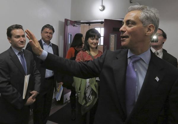 Mayor Rahm Emanuel leaves a news conference Tuesday in Chicago.