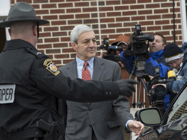 Former Penn State University President Graham Spanier leaves his arraignment before District Justice William Wenner in Lower Paxton Township, Dauphin County on Wednesday.