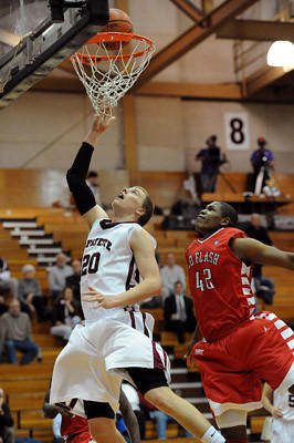 Lafayette's Dan Trist (left) drives to the basket in front of Saint Francis' Stephon Mosley (right) in the second half of their basketball game Tuesday night.