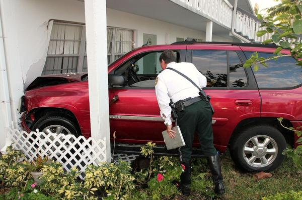 Broward Sheriff Deputy Steven Rossman investigates the crash in Century Village, in Deerfield Beach