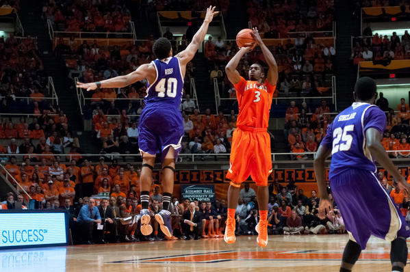 Illini guard Brandon Paul makes a three-pointer over Western Carolina's Preston Ross during the first half at Assembly Hall.