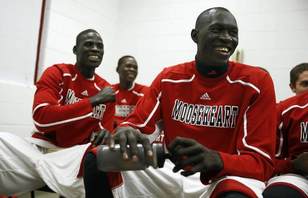 Mooseheart's Mangisto Deng, from left, Akim Nyang and Makur Puou laugh while watching game tape before playing Westminster Christian Tuesday. Earlier in the day, the three Sudanese students were cleared to play after being ruled ineligible by the IHSA on Monday.