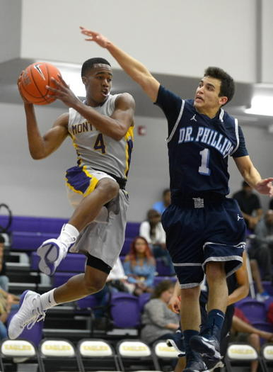 Montverde Academy's Kasey Hill, 4, drives to the basket in front of Dr. Phillips' Pedro Lalor, 1, in a 88-69 victory on Tuesday. (Special to the Sentinel/Phelan M. Ebenhack)