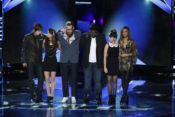 "Terry McDermott, left, Cassadee Pope, Nicholas David, Trevin Hunte, Melanie Martinez and Amanda Brown await their fates on ""The Voice."""