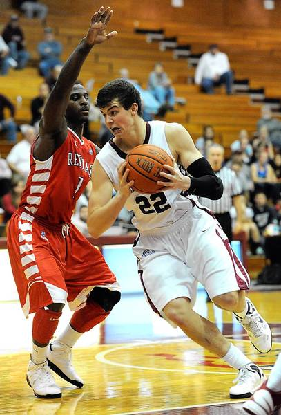 Lafayette's Alan Flannigan (right) drives to the basket in front of Saint Francis' Umar Shannon.