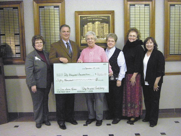 West Virginia University Hospitals-East City Hospital officials accept a $50,000 donation from the City Hospital Auxiliary for the Time Saves Lives capital campaign. Pictured from left are Director of Development Robin Zanotti, Chief Administrative Officer Anthony Zelenka, Auxiliary President Eleanor Jones, Vice President Nancy Poulson, Secretary Millie Watson and Treasurer Fran Auld.