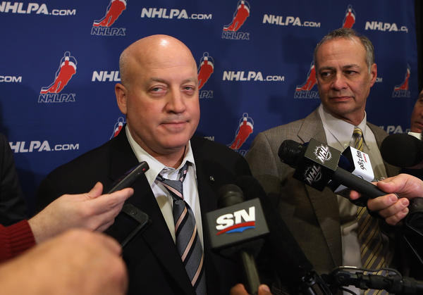 Bill Daly, Deputy Commissioner of the National Hockey League, and Steve Fehr, of the NHL Players Association, address the media following negotiations at the Westin Times Square Hotel on Tuesday.