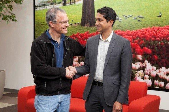 TripAdvisor CEO and President Stephen Kaufer, left, and Premal Shah, president of online microloan website Kiva, shake on the partnership that allows travelers who write reviews to loan money to worthy borrowers.