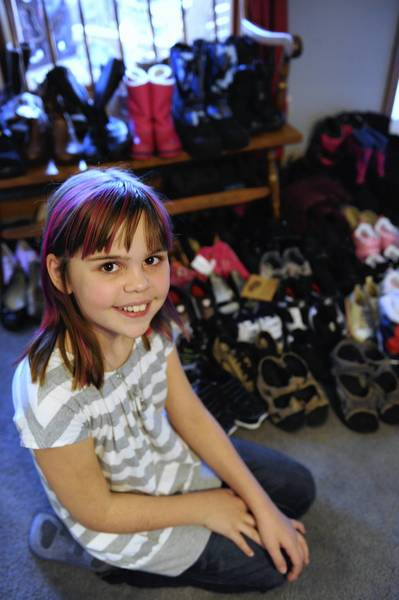 Lauryn Cottrell, 10 , of Northampton, collected 91 pairs of shoes in five weeks to donate to the poor. She's calling her effort Little Soles for Little Soles.