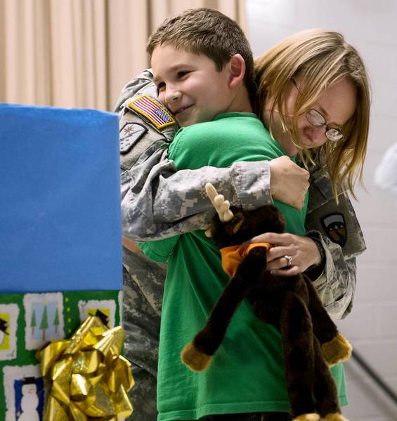 Army Capt. Anne Scott surprises her son Tyler, a third grader at Deibler Elementary School, by showing up at his school after her return from Kuwait.