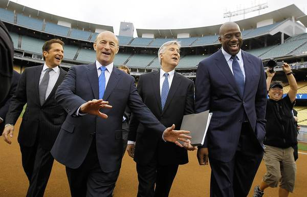 "The new Dodger owners -- from left, Peter Guber, Stan Kasten, Mark Walter and Earvin ""Magic"" Johnson, are expected to get $6 billion-plus for the TV rights to their team's games."