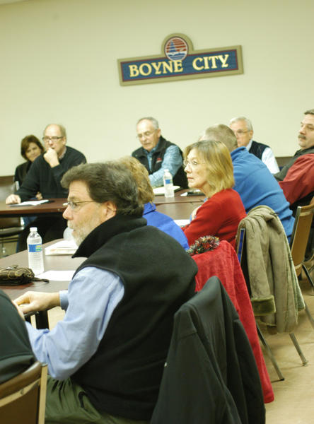 City officials gathered Tuesday to discuss the past and pending projects of the various committees, commissions and boards in Boyne City. Pictured at front is Main Street manager Hugh Conklin.