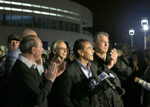 L.A. Mayor Antonio Villaraigosa is joined by union officials and management representatives in announcing the end of a walkout that hobbled the nation's busiest seaport complex for eight days.