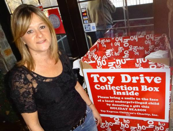 Lisa Flores is a manager at the Evviva! Bar & Eatery, one of the Lisle businesses participating in toy drives this season.