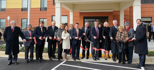 Among those attending the recent ribbon cutting at TownePlace Suites by Marriott in Frederick, Md., are, from left, Michael Henningsen, director of hotel operations for Plamondon Hospitality Partners; Gordon Paik, investor, TownePlace Suites Frederick; Blaine Young, Frederick County (Md.) commissioner; Myron Levy, investor, TownePlace Suites Frederick; Gail Plamondon, wife of Pete Plamondon Jr.; Meg Plamondon, daughter of Pete Plamondon Jr.; Amy Plamondon, daughter of Pete Plamondon Jr.; Pete Plamondon Jr., co-president of Plamondon Hospitality Partners and owner of TownePlace Suites Frederick; Liam Brown, chief officer, owner and franchise services chief operations officer, Select Service and Extended Stay Lodging The Americas/Marriott International Inc.; Jim Plamondon, co-president of Plamondon Hospitality Partners and owner of TownePlace Suites Frederick; Cary Plamondon, wife of Jim Plamondon; Susan Lent-Cohen, investor, TownePlace Suites Frederick; John Fieseler, executive director of the Tourism Council of Frederick County Inc.; Lorraine Plamondon, wife of Pete Plamondon Sr.; Pete Plamondon Sr., founder of Plamondon Hospitality Partners; and Paul Frey, vice president of the Frederick County Chamber of Commerce.