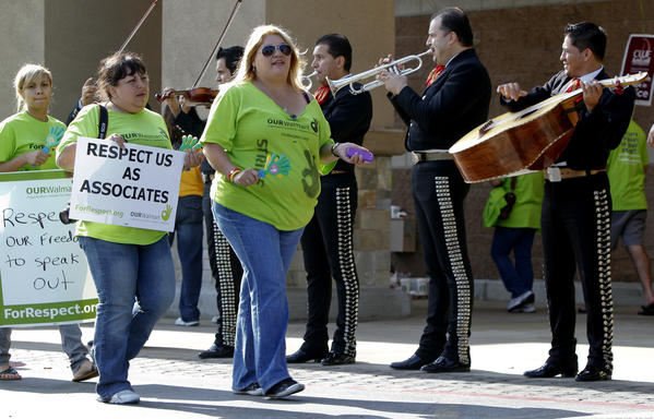 Wal-Mart workers protested on Black Friday around Southern California, complaining about the increasingly early start to the post-Thanksgiving shopping push while also agitating for higher wages and better healthcare. The giant discounter said in a statement that nearly 10 million register transactions occurred at stores between 8 p.m. and midnight on Thanksgiving. In October, dozens of workers - including some from Los Angeles - walked off the job. They accused Wal-Mart of retaliating against dissatisfied, vocal employees.