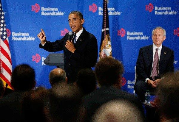 U.S. President Barack Obama speaks at the Business Roundtable while Boeing Chief Executive Officer James McNerney (R) listens, in Washington December 5, 2012.