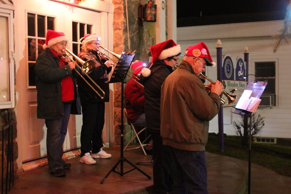 A brass band will lead carol singing at the Ellsworth Wooden Shoe Festival on Wednesday, Dec. 12.