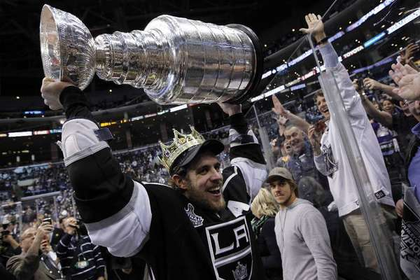 Los Angeles Kings center Anze Kopitar gives fans an up-close look at the Stanley Cup after L.A. defeated the New Jersey Devils to claim the trophy at Staples Center.
