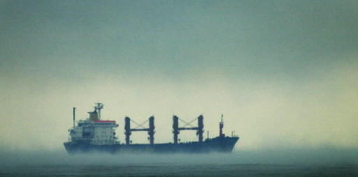 Clouds and mist engulf a freighter off Fort Lauderdale.