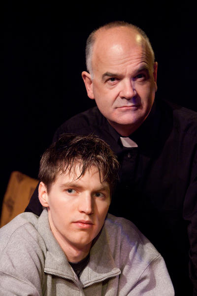 "Thomas Ouellette, as a priest, and Peter Travis, as a seminarian, star in ""Mass Appeal."""