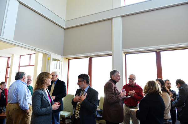 Muhlenberg College's faculty and staff members mingle during a reception for Muhlenberg professor Joseph Elliott who has a book about Bethlehem Steel. Muhlenberg College is a Top Workplace.