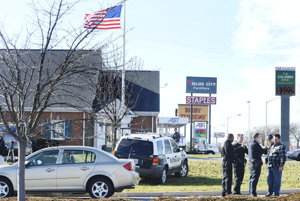 Hagerstown Police officers investgate a robbery Wednesday morning at the Columbia Bank on Wesel Boulevard.