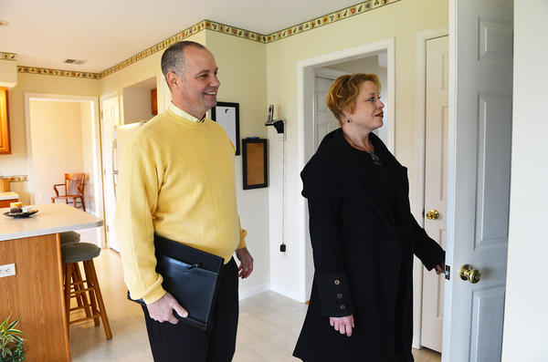 Prudential Patt, White Real Estate Realtor Mick Seislove (left) shows Sue Grubb, of Macungie a listed home. Seislove has been with Prudential Patt, White Real Estate for 12 years.