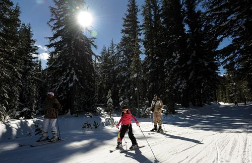 Skiers take advantage of the early snowfall at Mammoth Mountain resort.