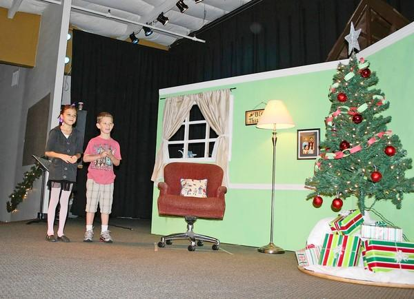 Emily Lemonnier, left, and Jordan Garland rehearse for ShoreLife Church's 10th annual Christmas Pageant, which took place Sunday.