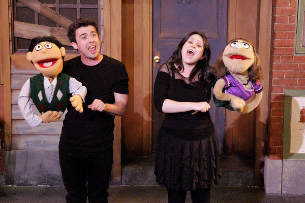 "Twentysomethings (puppets operated by Chris Kauffmann and Danielle Judovits) discover that ""Everyone's a Little Bit Racist"" in DOMA Theatre Company's ""Avenue Q."""