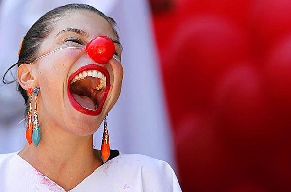 A woman appears to be having way too much fun during a clown parade on Dec. 5. The parade is part of a week-long clown festival taking place in Rio de Janeiro, Brazil.
