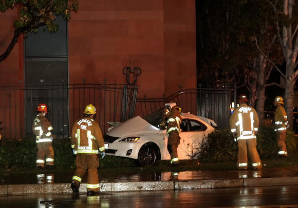 Burbank firefighters assess the damage of a fatal crash early Sunday, Dec. 2, 2012.