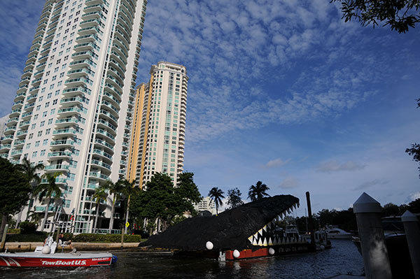Giant alligator head created by Hollywood artist Lloyd Goradesky,  Everglades historian Cesar Becerra and a team of collaborators makes it's way threw downtown Fort Lauderdale down the New River Wednesday afternoon.
