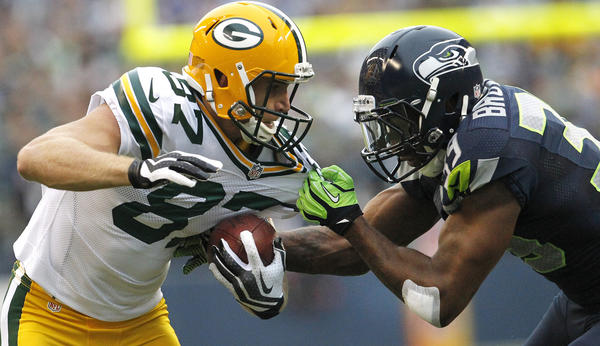 The Packers' Jordy Nelson is taken down by the Seahawks' Brandon Browner after a short reception during the first quarter of their game in Seattle on Sept. 24.