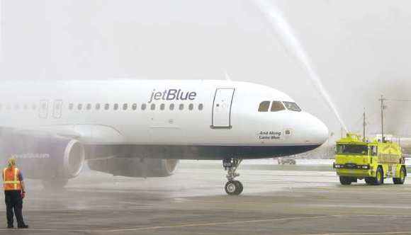 Fire trucks spray water over the JetBlue airplane that made the first trip from New York City to Bob Hope Airport in 2005.