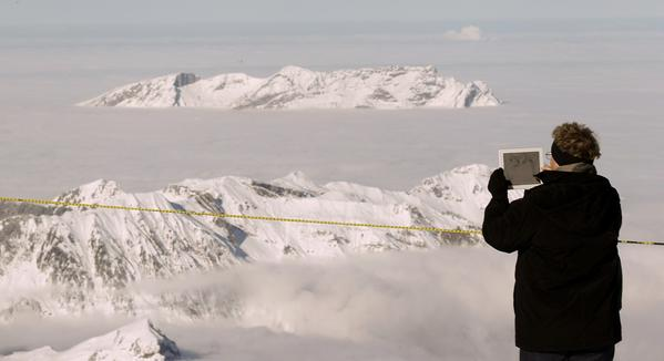 A woman uses her iPad to take a picture at the Mt. Titlis skiing area near the Swiss mountain resort of Engelberg Dec. 1, 2012.