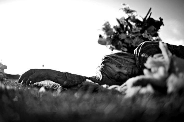 Leslie Greenberg lies in the grass at a park after leaving flowers at the nearby grave of her boyfriend Andrew Corless, who died in 2006 of prescription drug and alcohol intoxication. (Liz O. Baylen / Los Angeles Times)