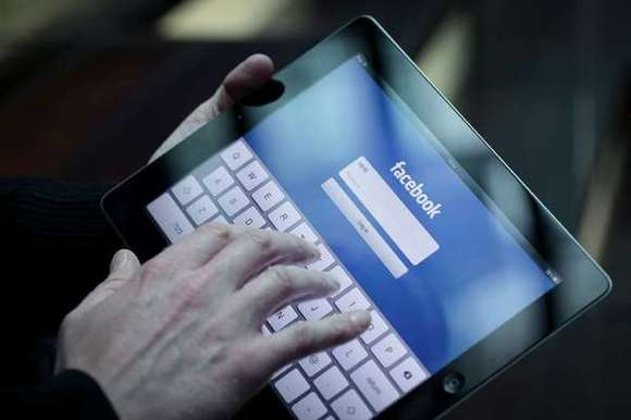 Facebook Inc. is seen on the landing page of the company's Apple  iPad application.