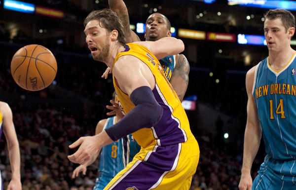 Lakers power forward Pau Gasol, battling Lance Thomas and Jason Smith (14) for a rebound last season, will sit out tonight's game against the Hornets.